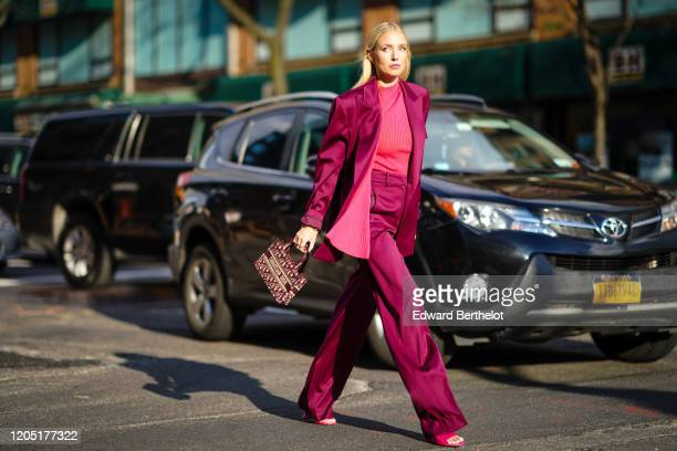 Leonie Hanne wears a purple lustrous silky oversized blazer jacket, a pink striped top, flared pants, pink sandals, a Christian Dior mini tote bag,...