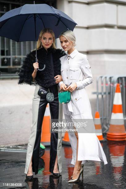 Leonie Hanne wears Chanel earrings a black frilly cape black and white leather pants a black Chanel beltbag a grey tweed Chanel coin purse black...