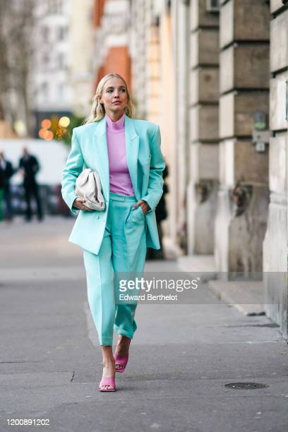 Leonie Hanne wears earrings a mauve hineck top a seagreen jacket matched crop cuffed pants hot pink sandals a creamcolor quilted clutch outside Ralph...