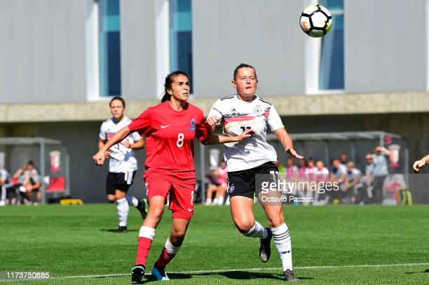 Leonie Koster of Germany competes for the ball with Aytaj Nematova of Azerbaijan during the UEFA Women's U19 European Championship Qualifier match...