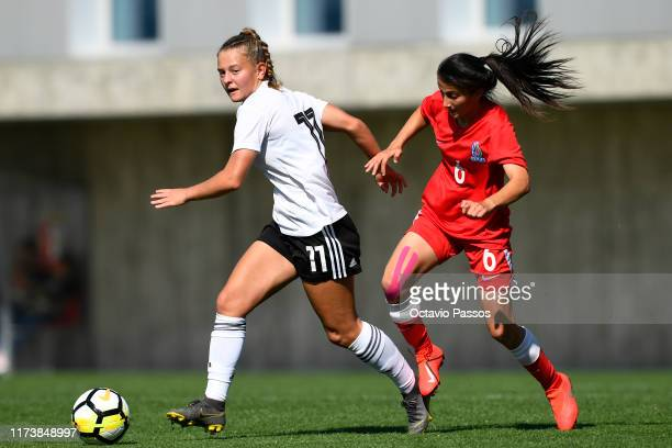 Leonie Koster of Germany competes for the ball with Sona Rahimova of Azerbaijan during the UEFA Women's U19 European Championship Qualifier match...