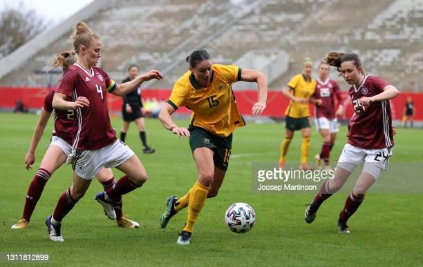 Leonie Maier and Jana Feldkamp of Germany battle for possession with Emily Gielnik of Australia during the Women's International Friendly match...