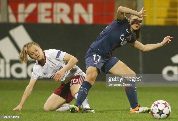 Leonie Maier of Bayern fights for the ball with Eve Perisset of Paris St Germain during the UEFA women's champions league quarter finals at Stadion...