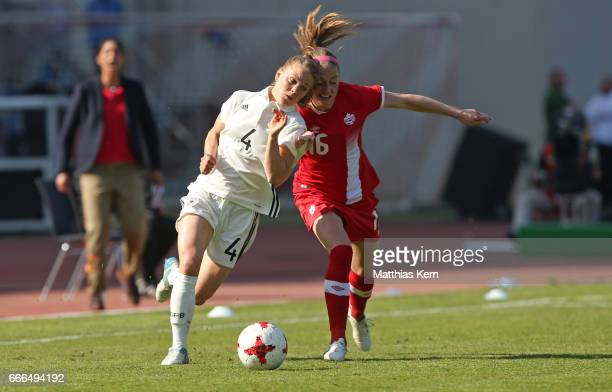 Leonie Maier of Germany battles for the ball with Janine Beckie of Canada during the women's international friendly match between Germany and Canada...