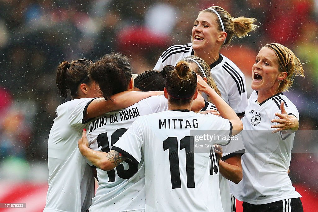 Leonie Maier (hidden) of Germany celebrates her team's first goal with team mates during the Women's International Friendly match between Germany and Japan at Allianz Arena on June 29, 2013 in Munich, Germany.