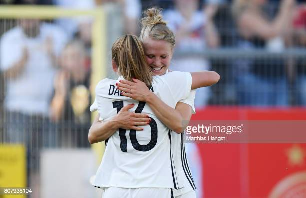 Leonie Maier of Germany celebrates with her teammates after scoring her team's third goal during the Women's International Friendly match between...