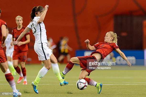 Leonie Maier of Germany challenges Alex Morgan of USA during the 2015 FIFA Women's World Cup semi final match at Olympic Stadium on June 30 2015 in...