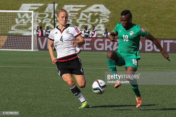 Leonie Maier of Germany defends against Binta Diakite of Cote d'Ivoire during the FIFA Women's World Cup Canada 2015 Group B match between Germany...
