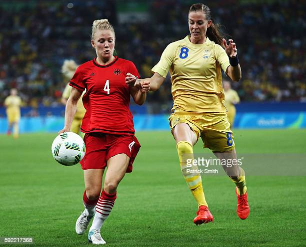 Leonie Maier of Germany holds off Lotta Schelin of Sweden during the Women's Olympic Gold Medal match between Sweden and Germany at Maracana Stadium...