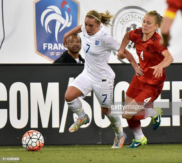 Leonie Maier of Germany holds the arm of Jordan Nobbs of England during the second half of a friendly international match in the Shebelieves Cup at...
