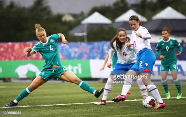 Leonie Maier of Germany is challenged by Birita Nielsen of Faeroe Islands during the Faeroe Islands Women's v Germany Women's 2019 FIFA Women's World...