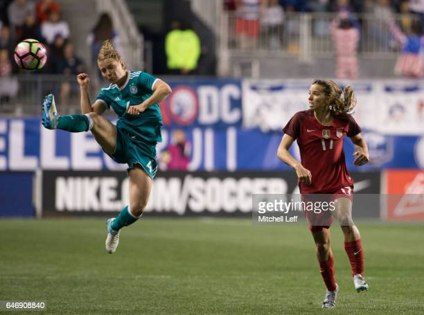 Leonie Maier of Germany kicks the ball against Tobin Heath of the United States of America in the second half during the SheBelieves Cup at Talen...