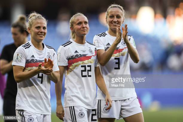 Leonie Maier , Turid Knaak and Kathrin Hendrich of Germany show appreciation to the fans after the 2019 FIFA Women's World Cup France group B match...