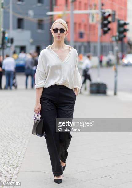 Leonie Markhorst wearing white blouse black pants during the MercedesBenz Fashion Week Berlin Spring/Summer 2018 at Kaufhaus Jandorf on July 6 2017...