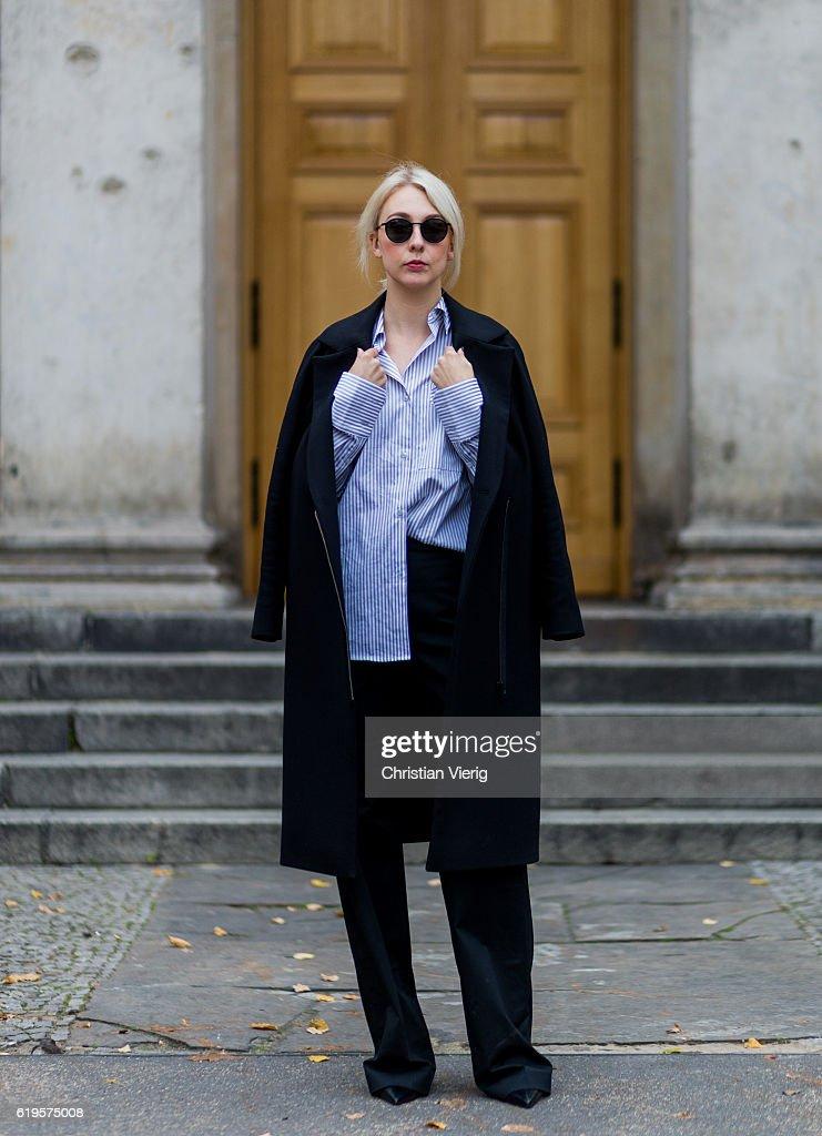 Leonie Markhorst (noanoir.com / @noanoir_) wears a black coat COS, a blue white stripped button shirt from Avelon, black pants from Avelon, black pumps Zign (via Zalando), black sunglasses Ace & Tate on October 31, 2016 in Berlin, Germany.