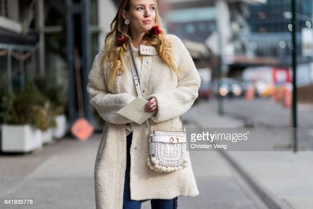 Leonie Sophie Hanne wearing a Chloe bag and Chloe heels creme coat outside Tory Burch on February 14 2017 in New York City