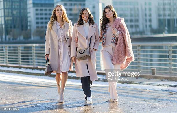 Leonie Sophie Hanne wearing a nude wool coat ruffled dress brown Marc Cain bag nude Marc Cain ankle boots with socks Nina Schwichtenberg wearing a...