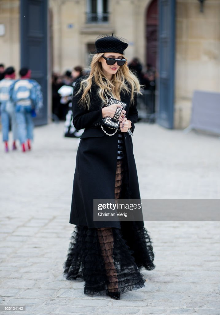 Leonie Sophie Hanne wearing hat, sunglasses, sheer dress is seen outside Dior on February 27, 2018 in Paris, France.