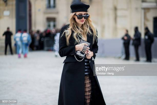 Leonie Sophie Hanne wearing hat sunglasses sheer dress is seen outside Dior on February 27 2018 in Paris France