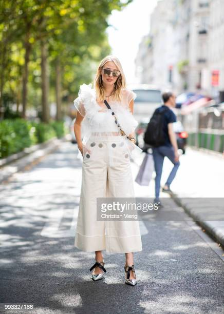 Leonie Sophie Hanne wearing white sheer ruffled top, cropped wide leg pants is seen outside Viktor & Rolf on day four during Paris Fashion Week Haute...