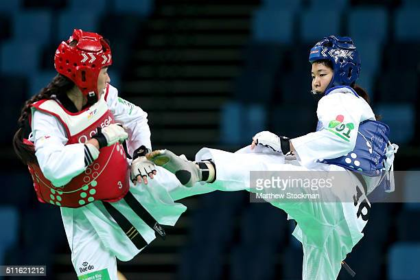 Leonor Dias of Brazil and Mayu Hamada of Japan compete during the International Taekwondo Tournament at the Olympic Park on February 21 2016 in Rio...