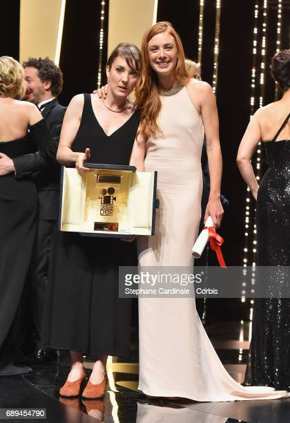 Leonor Serraille poses with the Camera d'Or for the movie 'Jeune Femme' and actress Laetitia Dosch during the Closing Ceremony during the 70th annual...