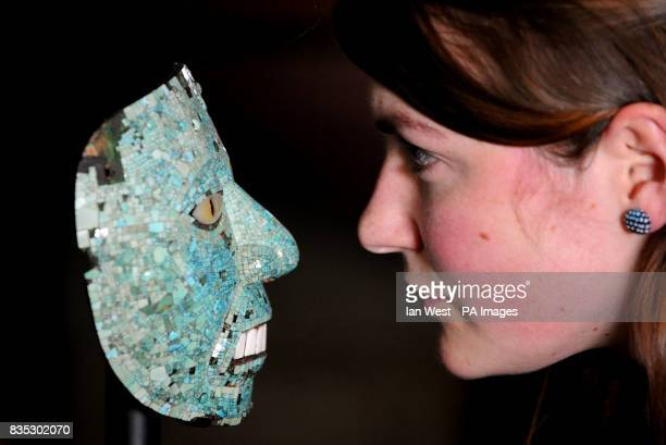 Leonora BairdSmith Museum assistant for Latin America is seen with an Aztec mask possibly representing Xiuhtecuhtli made of Cedro wood and covered in...
