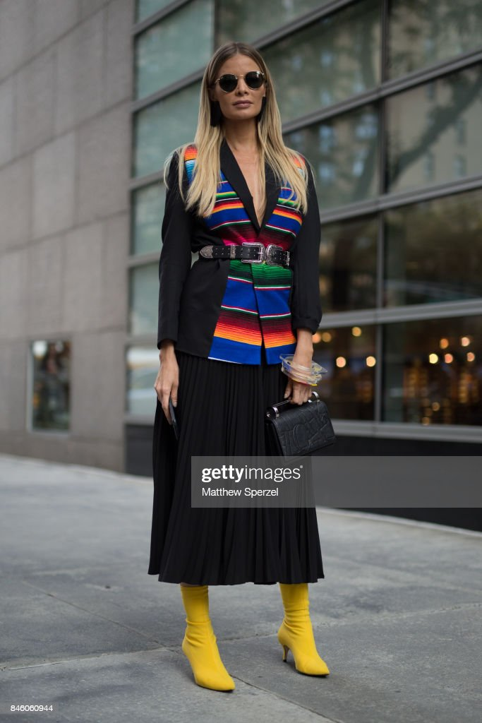 Leonora Jimenez is seen attending Oscar de la Renta during New York Fashion Week wearing multi color striped top with yellow heels on September 11, 2017 in New York City.