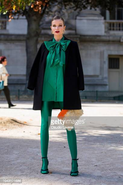 Leonora Jimenez wearing a green blouse with matching tights black sandals black coat and orange fur bag is seen before the Elie Saab show on...