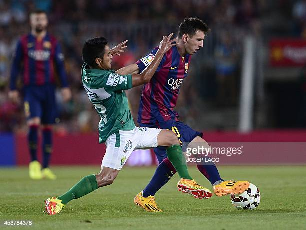 Leon's defender Jose Juan Vazquez vies with Barcelona's Argentinian forward Lionel Messi during the 49th Joan Gamper Trophy football match FC...