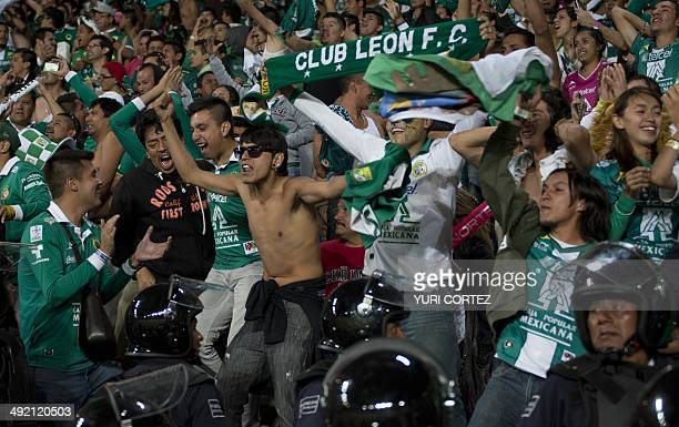 Leon's fans celebrate after their team defeating Pachuca during their Clausura 2014 Mexican tournament football final match at the Hidalgo stadium in...