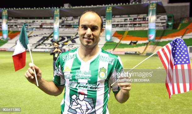 Leon´s new footballer Landon Donovan of the US poses with the team´s jersey during his official presentation at the Nou Camp stadium on January 15 in...