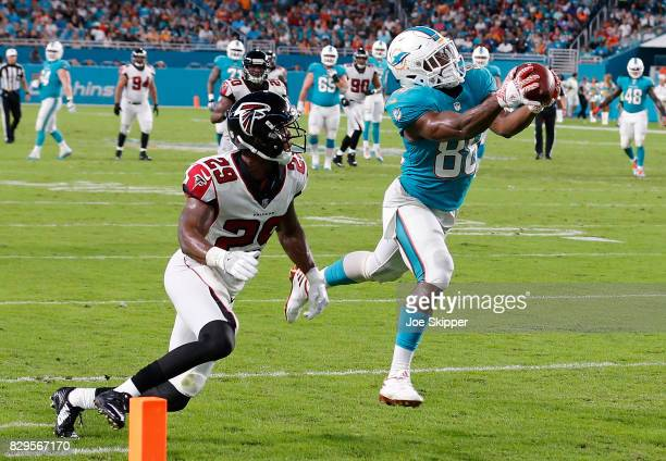 Leonte Carroo of the Miami Dolphins catches Atlanta Falcons pass for Atlanta Falcons second quarter touchdown pass as CJ Goodwin of the Atlanta...