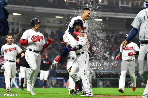 Leonys Martin celebrates with Tyler Naquin of the Cleveland Indians after Naquin drove in Martin for a walkoff single during the ninth inning against...