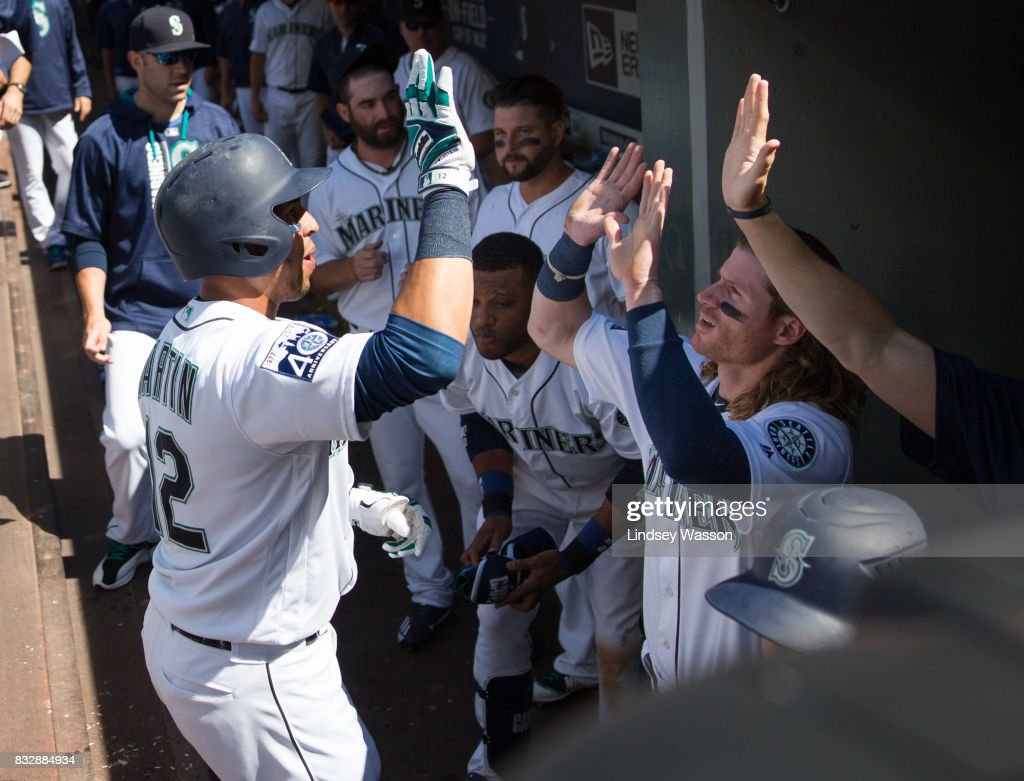 Leonys Martin #12 of the Seattle Mariners is greeted by Ben Gamel #16 (R) after hitting a home run in the sixth inning at Safeco Field on August 16, 2017 in Seattle, Washington.