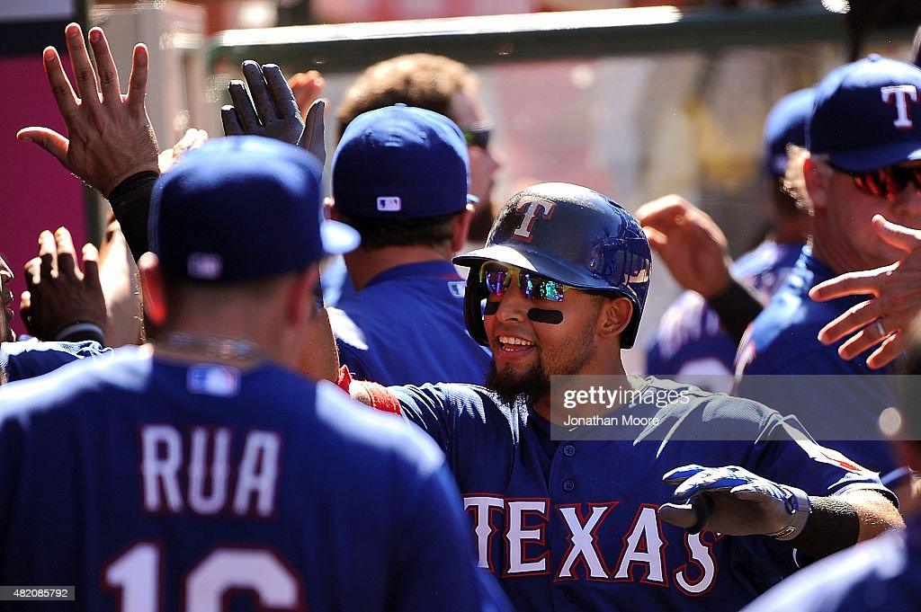 Leonys Martin #2 of the Texas Rangers celebrates after scoring on a two-run home run hit by Rougned Odor #12 (not pictured) in the ninth inning during a game against the Los Angeles Angels of Anaheim at Angel Stadium of Anaheim on July 26, 2015 in Anaheim, California. The Angels beat the Rangers 7-13.