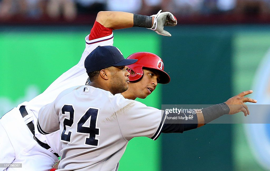 Leonys Martin #2 of the Texas Rangers is tagged out by Robinson Cano #24 of the New York Yankees at Rangers Ballpark in Arlington on July 22, 2013 in Arlington, Texas.