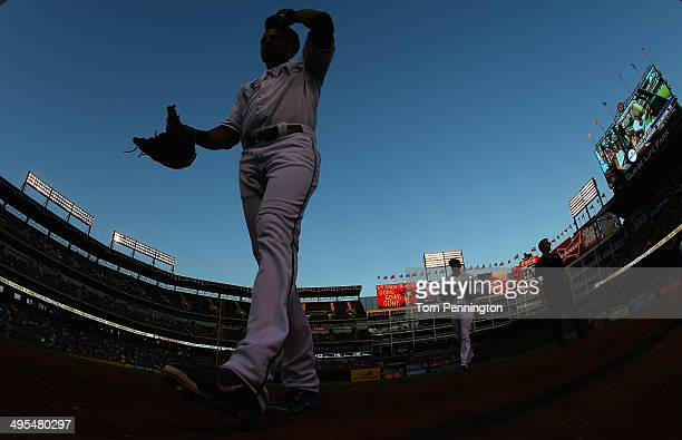 Leonys Martin of the Texas Rangers returns to the dugout after closing out the top of the fourth inning against the Baltimore Orioles at Globe Life...