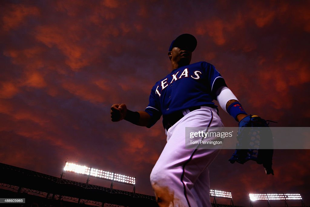 Leonys Martin #2 of the Texas Rangers returns to the dugout in the middle of the fourth inning as the Texas Rangers take on the Colorado Rockies at Globe Life Park in Arlington on May 8, 2014 in Arlington, Texas.