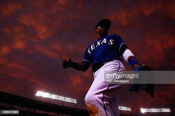 Leonys Martin of the Texas Rangers returns to the dugout in the middle of the fourth inning as the Texas Rangers take on the Colorado Rockies at...