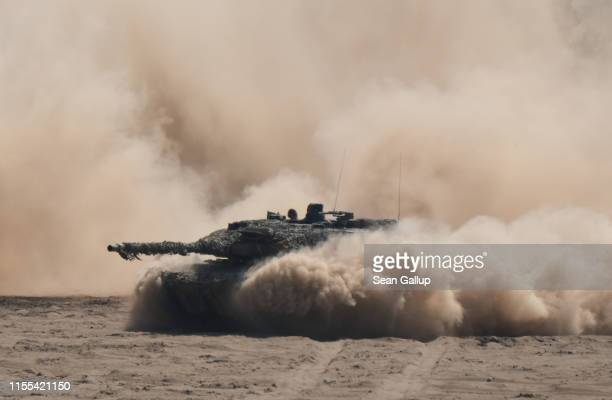 Leopard 2 main battle tank of the Bundeswehr, the German armed forces, takes part in the NATO Noble Jump military exercises during a live fire...