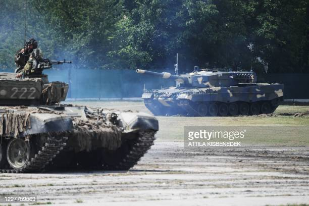 Leopard 2/A4 battle tanks are seen during a handover ceremony of tanks at the army base of Tata, Hungary, on July 24, 2020. - The Hungarian Army...