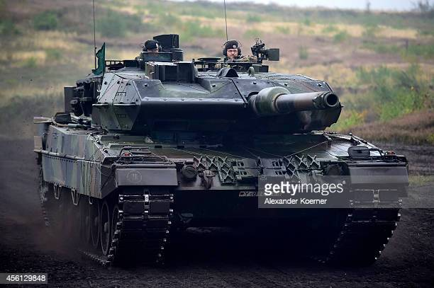 Leopard 2A5 tank is driven by members of the Bundeswehr the German armed forces during the annual military exercises at the Bundeswehr training...