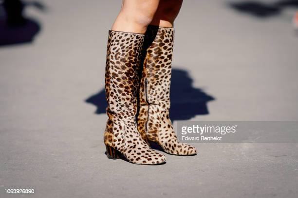 Leopard print boots are seen outside Margiela during Paris Fashion Week Womenswear Spring/Summer 2019 on September 26 2018 in Paris France