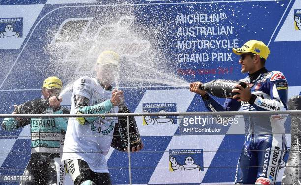 Leopard Racing Honda rider Joan Mir of Spain celebrates with secondplace Honda rider Livio Loi of Belgium and thirdplace Del Conca Gresini Honda...