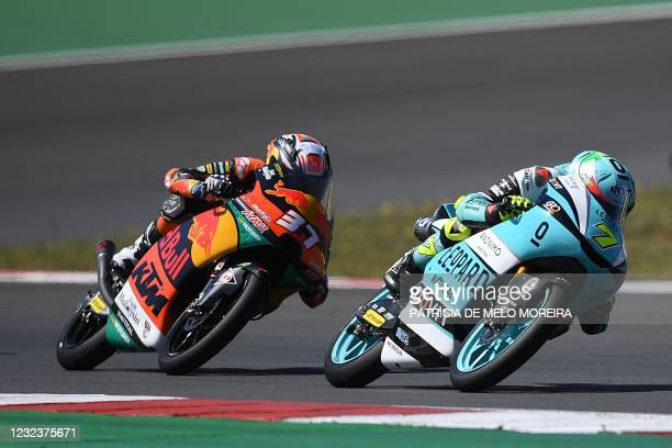 Leopard Racing's Italian rider Dennis Foggia and Red Bull KTM Ajo's Spanish rider Pedro Acosta compete in the Moto3 race of the Portuguese Grand Prix...