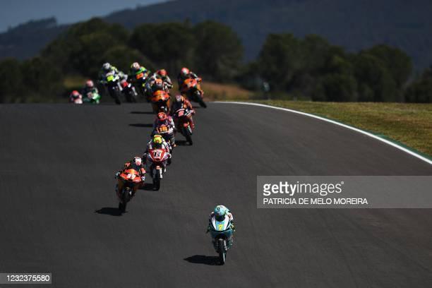 Leopard Racing's Italian rider Dennis Foggia leads the Moto3 race of the Portuguese Grand Prix at the Algarve International Circuit in Portimao on...