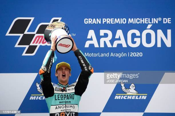 Leopard Racing´s Spanish rider Jaume Masia celebrates on the podium after winning the Moto3 race of the Moto Grand Prix of Aragon at the Motorland...
