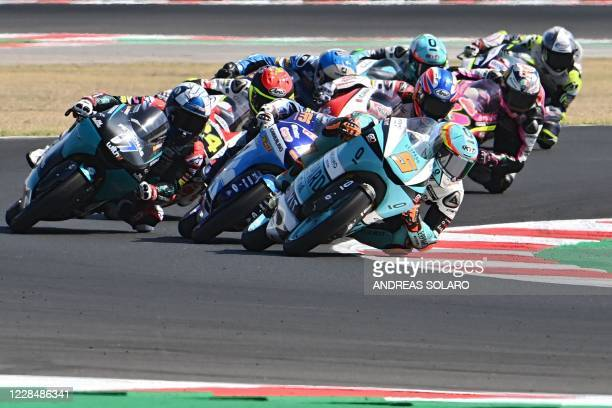 Leopard Racing's Spanish rider Jaume Masia leads the pack during the Moto3 race of the San Marino Grand Prix at the Misano World Circuit Marco...