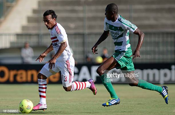 AC Leopards' player Eric Nyemba Tuboko challenges Zamalek's Youssef Hassan for the ball during their AFC Champions League Group A football match at...